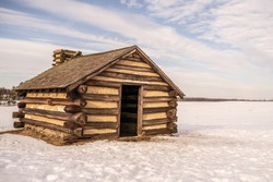 Log cabins after snow at Valley Forge National Historic Park, Pennsylvania