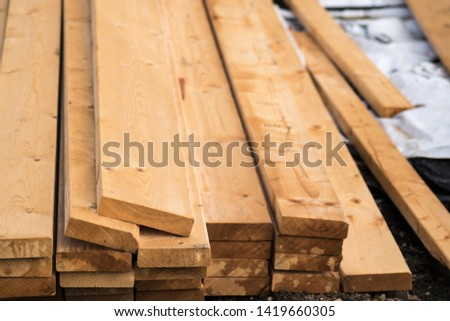 log of timber wood for home use laying down on the ground #1419660305