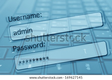 Login Box With Filled-in Username and Password in Internet Browser. Computer Keyboard in Background.