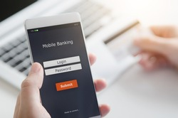 Login to mobile banking account on smart phone. Making payment by mobile application.