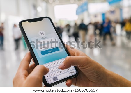 Login with smartphone to online bank account or personal information on internet. Registration to social media app. Hands typing and entering username and password to an imaginary mobile application. #1505705657