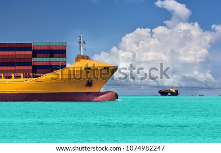 Logistic and Transportation of international Container ship forward yellow sailing to ocean at blue sky background
