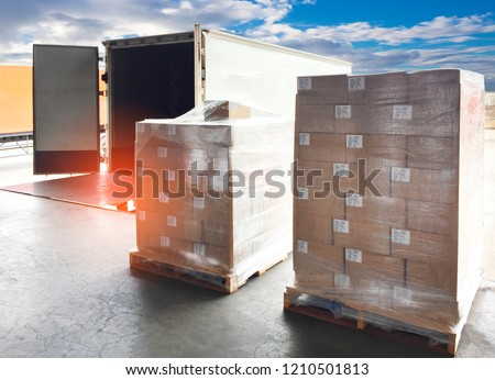Logistic and warehouse. The shipment pallet at docks for loading into a truck.