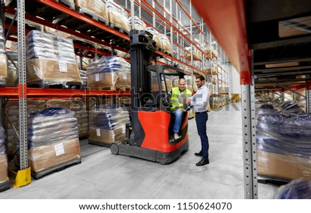 logistic business, shipment and people concept - warehouse worker and businessman with tablet pc computer and tablet pc computer #1150624070