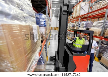 logistic business, shipment and people concept - warehouse worker and businessman with tablet pc computer and tablet pc computer #1152717362