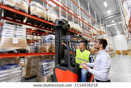 logistic business, shipment and people concept - warehouse worker and businessman with tablet pc computer and tablet pc computer #1156838218