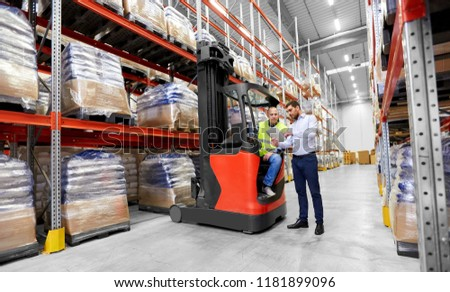 logistic business, shipment and people concept - warehouse worker and businessman with tablet pc computer and tablet pc computer #1181899096