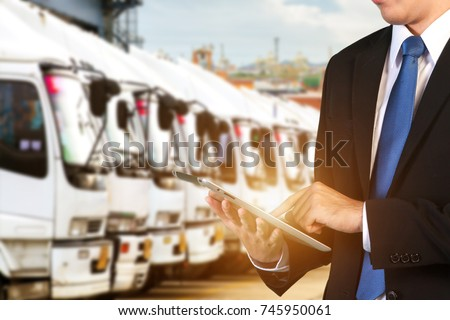 Logistic Concept, Manager working with tablet and smartphone for Import Export background