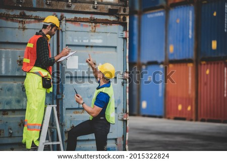 logistic worker teamwork and partner of foreman, engineer, and businessman working in an international shipping area, concept of business industrial and working in container yard to import and export ストックフォト ©