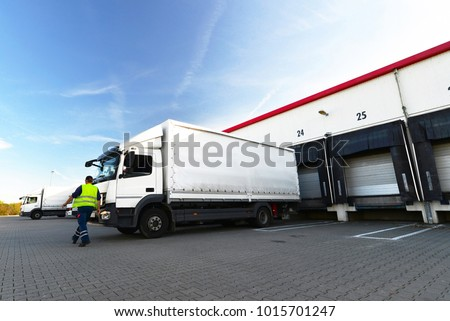 logistics and goods storage - loading and unloading of goods for transport by truck