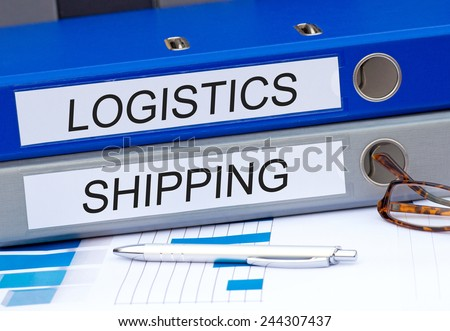 Logistics and Shipping - two binders on desk in the office #244307437