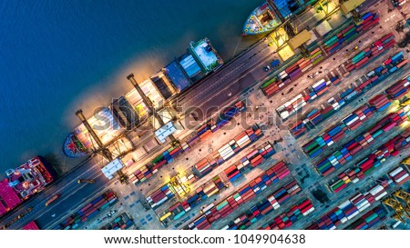 Logistics and transportation of Container Cargo ship and Cargo plane with working crane bridge in shipyard at sunrise, logistic import export and transport industry background #1049904638