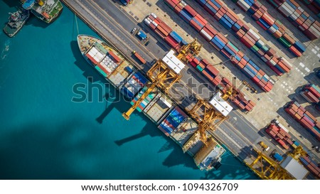 Logistics and transportation of Container Cargo ship and Cargo plane with working crane bridge in shipyard, logistic import export and transport industry background #1094326709