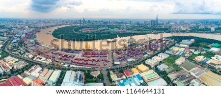Photo of Logistics and transportation of Container Cargo ship and Cargo plane with working crane bridge in shipyard, logistic import export and transport industry background, Ho Chi Minh city, Vietnam