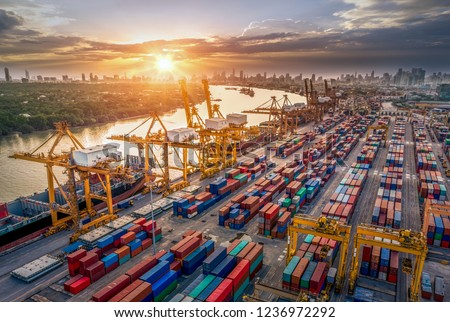 Logistics and transportation of Container Cargo ship and Cargo plane with working crane bridge in shipyard at sunrise, logistic import export and transport industry background #1236972292