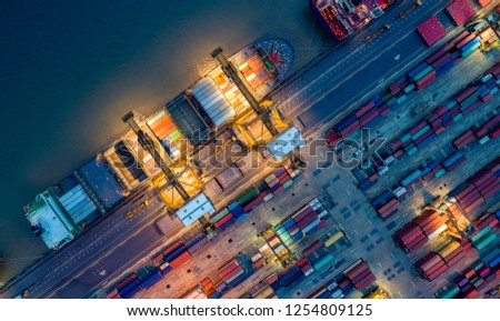 Logistics and transportation of Container Cargo ship and Cargo plane with working crane bridge in shipyard at sunrise, logistic import export and transport industry background #1254809125