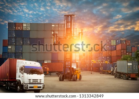 Logistics and transportation of Container Cargo ship and Cargo plane with working crane bridge in shipyard at sunrise, logistic import export and transport industry background #1313342849