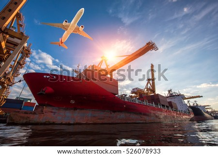 Logistics and transportation of Container Cargo ship and Cargo plane with working crane bridge in shipyard, logistic import export and transport industry background #526078933