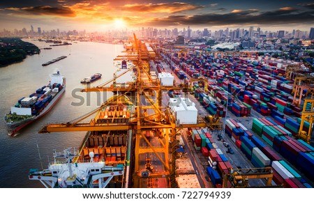 Logistics and transportation of Container Cargo ship and Cargo plane with working crane bridge in shipyard at sunrise, logistic import export and transport industry background #722794939