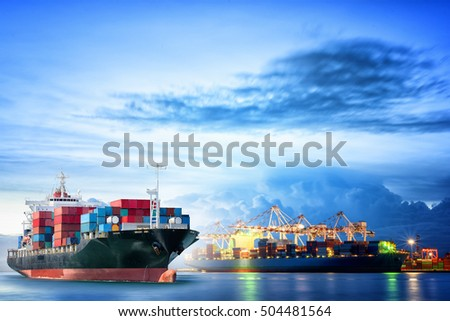 Logistics and transportation of international container cargo ship with ports crane bridge in harbor at dusk for logistics import export background and transportation industry