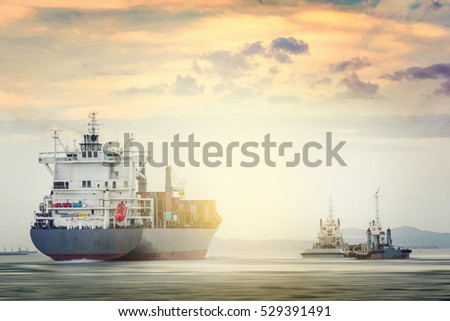 Logistics and transportation of International Container Cargo ship with tugboat in the ocean at sunset time, Freight Transportation, Shipping