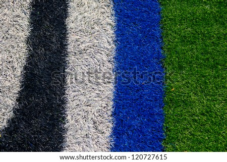 Logo in the center of an american football field with artificial turf