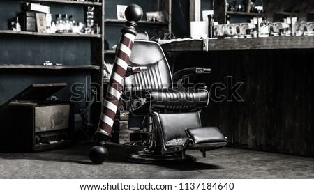 Logo of the barbershop, symbol. Stylish vintage barber chair. Hairstylist in barbershop interior. Barber shop chair. Barbershop armchair, salon, barber shop for men. Barber shop pole. Black and white.