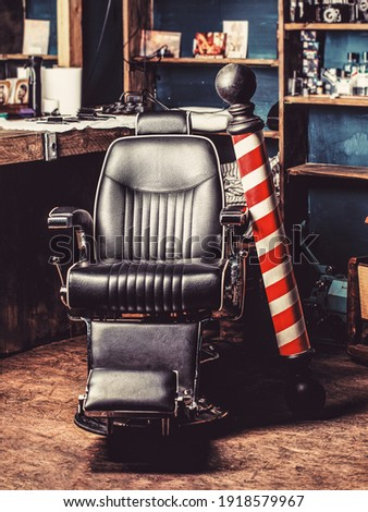 Logo of the barbershop, symbol. Stylish vintage barber chair. Hairstylist in barbershop interior. Barber shop chair. Barbershop armchair, salon, barber shop for men. Barber shop pole. Photo stock ©