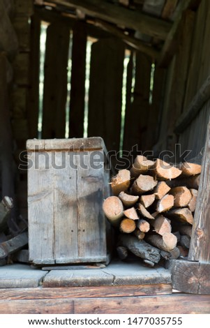 Logs stored in wooden shed