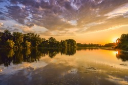 Loire river at sunset, colorful picture of the river loire with sun and clouds