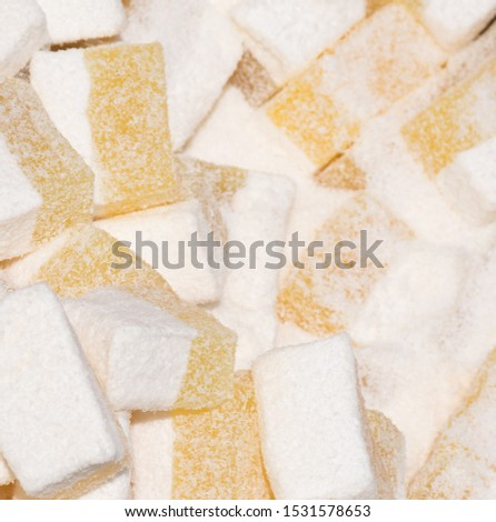 """Lokum the """"Turkish Delight"""", famous Istanbul sweet dessert, confectionery shop. Pink and white color dislay on counter top during street food festival. Traditional homemade specialty to sell in market"""