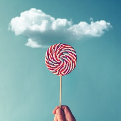 Lollipop candy on sky background. Summer concept.
