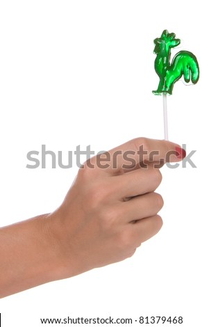 Lollipop in a hand isolated over white background - stock photo
