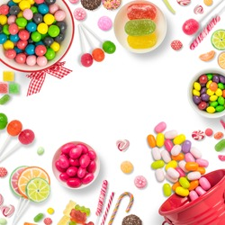 Lollipops and candies. Colorful sweets, festive decoration. Colorful candies on a white background, top view with copy space for message or greeting card. Concept of sweets and sugar. Copy space.
