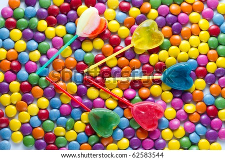 lollipops lying on colored candies