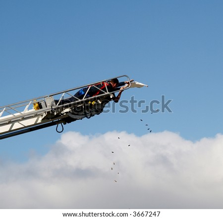Lolly Scramble Lollies being Dropped from Fire Truck Ladder