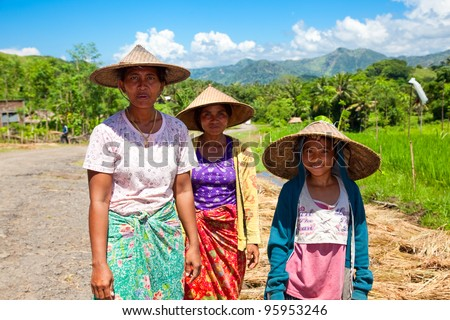 LOMBOK,INDONESIA- FEBRUARY 12: Local people after harvesting rice  on February 12,2012 in Lombok, Indonesia. Rice is more than just the staple food; it is an integral part of the Lombok culture