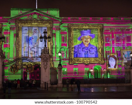 LONDON - APRIL  21: Buckingham Palace projection shows the portrait of Queen Elizabeth and self-portraits of young people in the art project Face Britain on April 21, 2012 in London