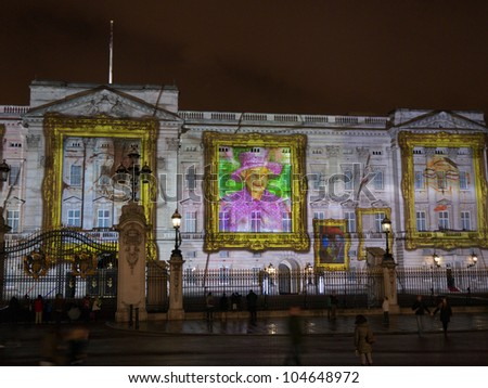 LONDON - APRIL  21 - Buckingham Palace projection shows the portrait of Queen Elizabeth, self-portraits of young people  in the art project Face  Britain on April 21, 2012 in London