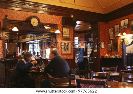 LONDON - APRIL 30: Interior of pub, for drinking and socializing, focal point of the community, on April 30, 2006, London, UK. Pub business, now about 53,500 pubs in UK, has been declining every year