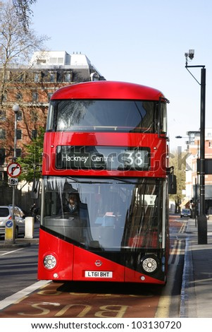 LONDON - APRIL 30: London's new bus, also called Boris Bus or hybrid NB4L, 50% more fuel efficient, on April 30, 2012, London, UK. It is a 21st century replacement of the iconic Routemaster for London - stock photo