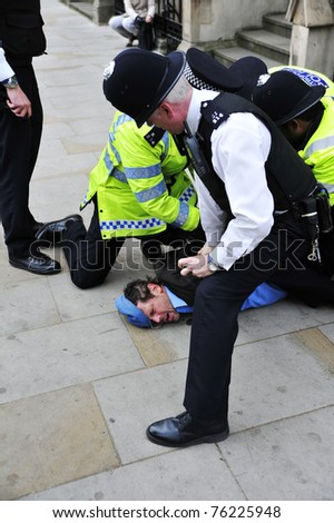 LONDON - APRIL 29 - Police detain an unidentified man for breaking through the security cordon at the Royal Wedding of Prince William and Kate Middleton at Westminster Abbey in London, England.