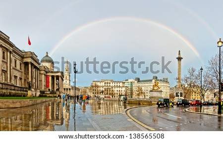 LONDON - APRIL 12: rainbow over Trafalgar Square on April 12, 2013 in London. The capital of UK is one of the most popular tourist attraction on Earth, with more than fifteen million visitors a year