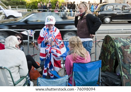 LONDON - APRIL 27: Royal family fans camp to secure a good spot at Westminster Abbey for the royal wedding celebration to take place April 29. April 27, 2011 in London, England.