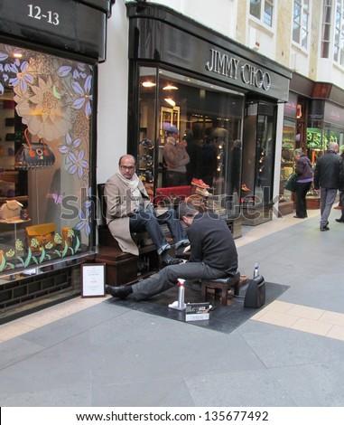 APRIL 10: Shoe shine man outside londons famous Burlington arcade