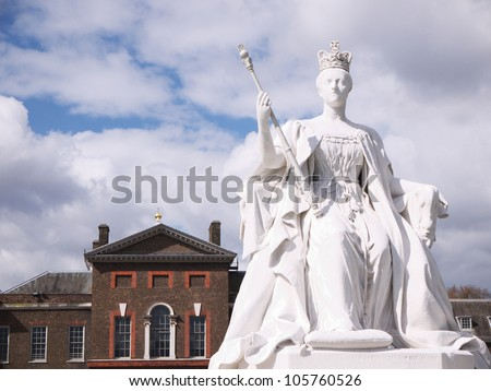 LONDON - APRIL 21: Statue of Queen Victoria of England in front of Kensington Palace on April 21, 2012 in London. The palace host a permanent exhibition on Victoria, its most famous former resident.