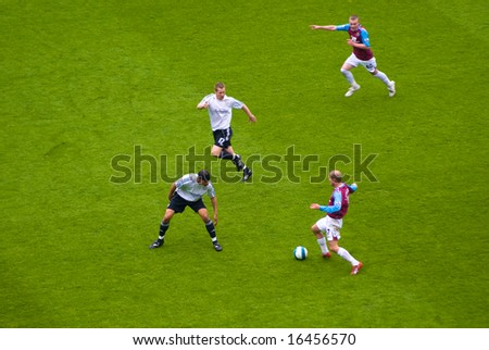 LONDON - APRIL 19: Swedish captain Ljundberg (R) leads a fast paced counter attack during the West Ham vs Derby County game on April 19, 2008 in London.