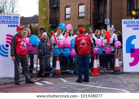LONDON - APRIL 22: Unidentified spectators support the runners at the London marathon on April 22, 2012 in London, England, UK. The marathon is an annual event.