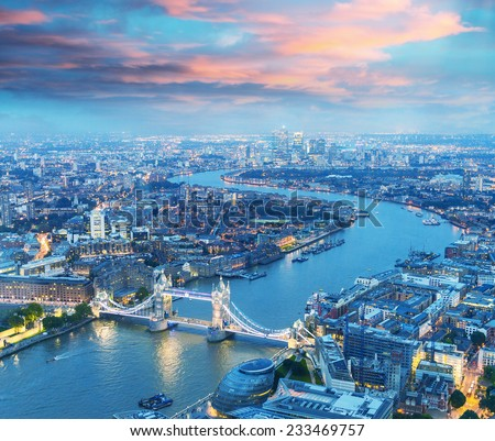 London at night. Aerial view of Tower Bridge area and city lights.