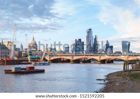 London at sunset with St Paul Cathedral, Blackfriars Bridge and the City of London